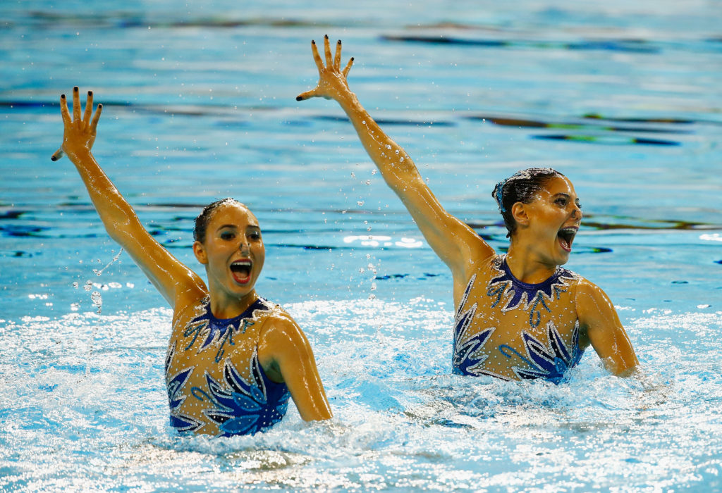 TORONTO, ON - JULY 11: Kelley Kobler and Natalie Lubascher of Chile perforn during the Women's Duet Synchronized Swimming Final on July 11, 2015 in Toronto, Canada.   Al Bello/Getty Images/AFP
