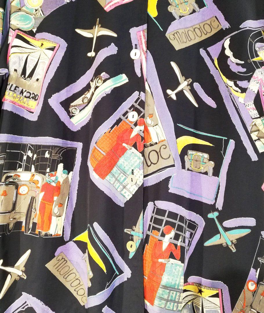 Blusa tipo guayabera con diseños de figurines